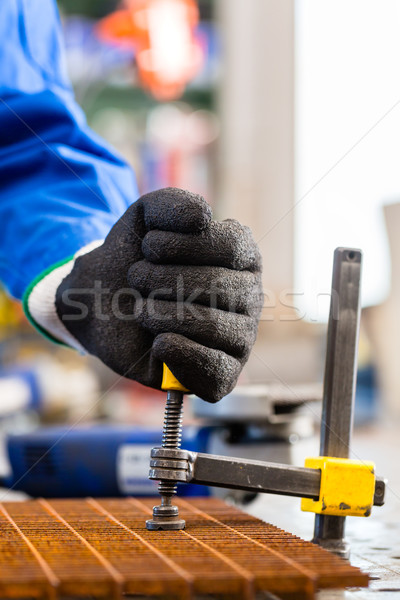 Workshop craftsman clamping metal on workbench Stock photo © Kzenon