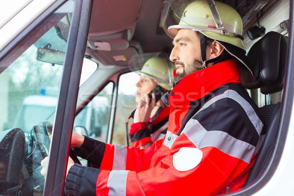 Emergency doctor and nurse driving ambulance  Stock photo © Kzenon
