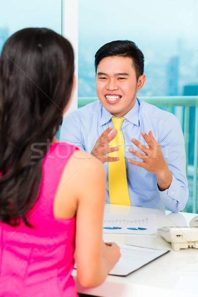 азиатских советник клиент финансовых инвестиции женщину Сток-фото © Kzenon