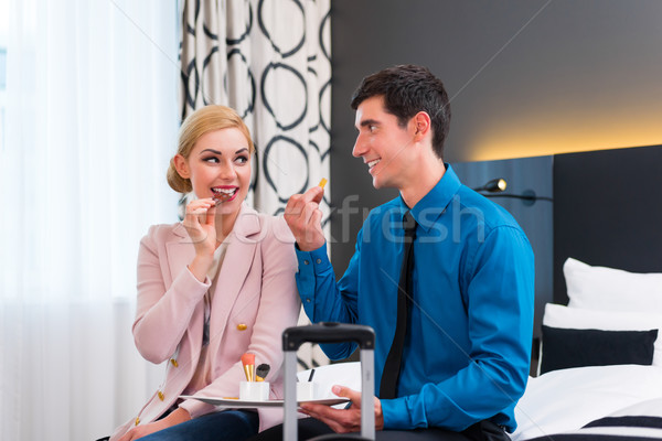 Man and woman arriving in hotel room Stock photo © Kzenon