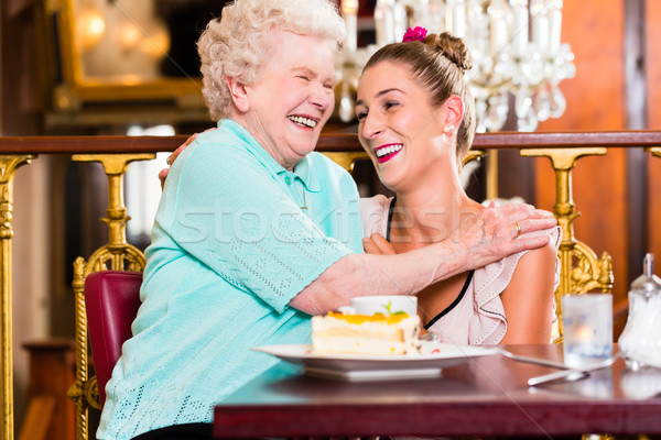 Granny and granddaughter laughing in cafe Stock photo © Kzenon