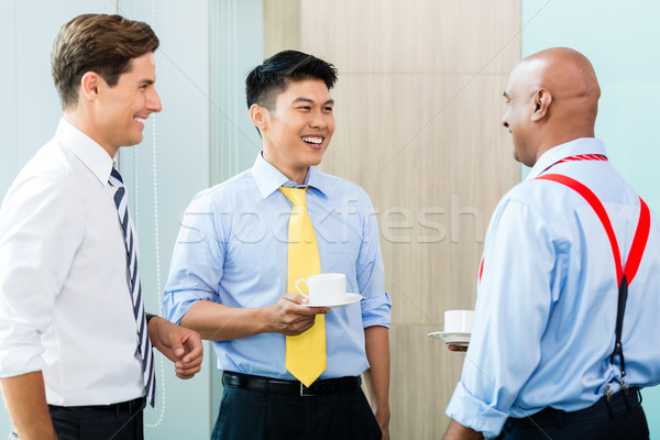 Business team in informal coffee meeting Stock photo © Kzenon
