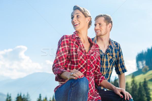Man and woman hiking the alpine mountains Stock photo © Kzenon