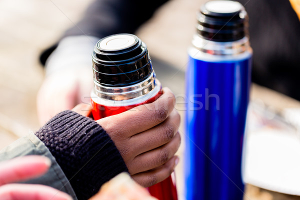 Close-up of hand holding a red vacuum insulated bottle outdoors Stock photo © Kzenon