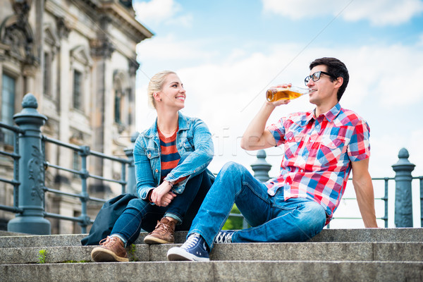 Berlin tourists enjoying view from Museum Island with beer Stock photo © Kzenon