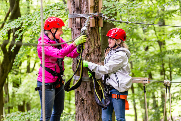 Family  in high rope course or park climbing Stock photo © Kzenon