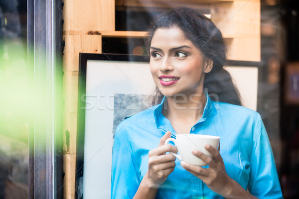 Indian woman with coffee mug Stock photo © Kzenon