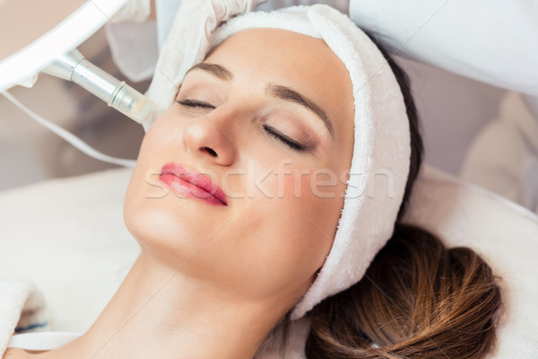 Close-up of the face of a woman relaxing during non-surgical fac Stock photo © Kzenon