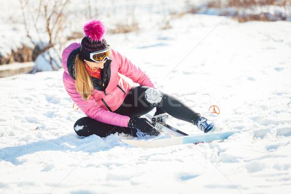 Woman falling while doing cross country skiing Stock photo © Kzenon