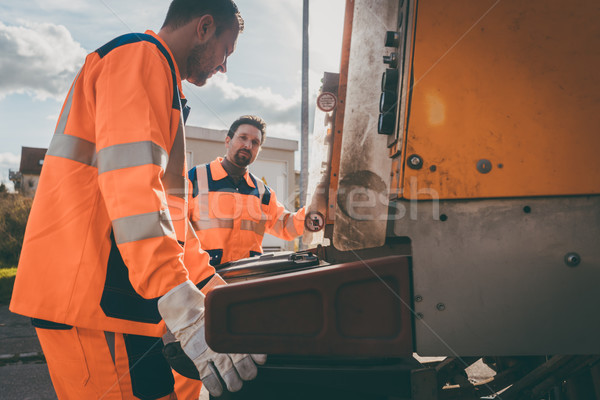 Stock photo: Garbage removal men working for a public utility