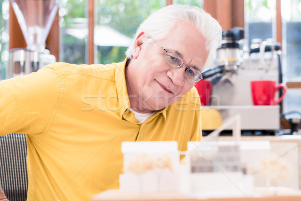 Asian architect studying an innovative residential project Stock photo © Kzenon