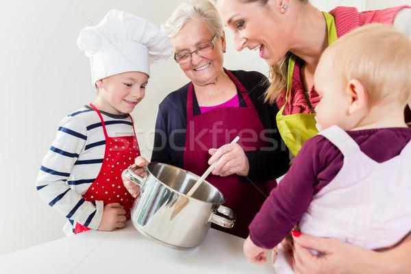 Család főzés háztartás boldog család nő gyerekek Stock fotó © Kzenon