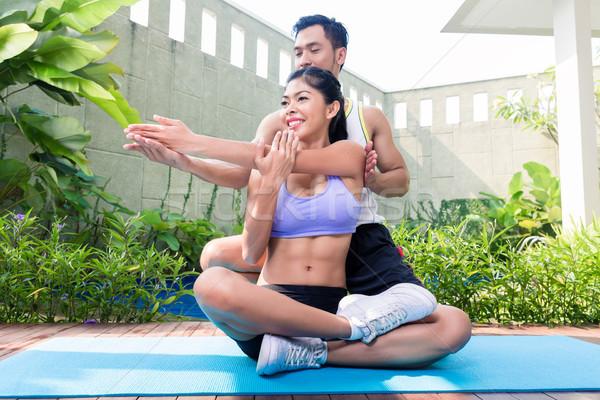 Asian fitness trainer exercising sport with woman Stock photo © Kzenon