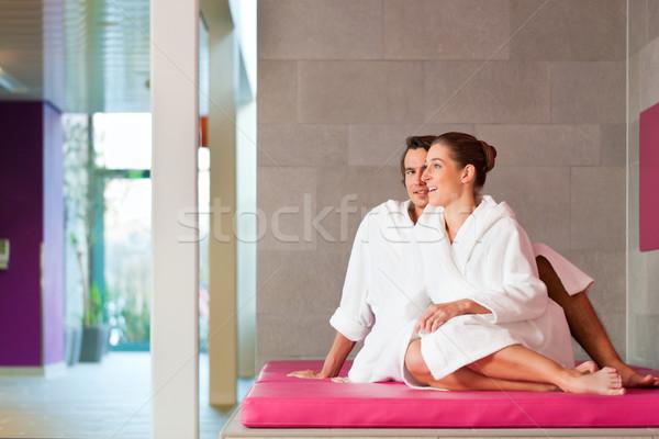 Young couple in bathrobe in Spa Stock photo © Kzenon