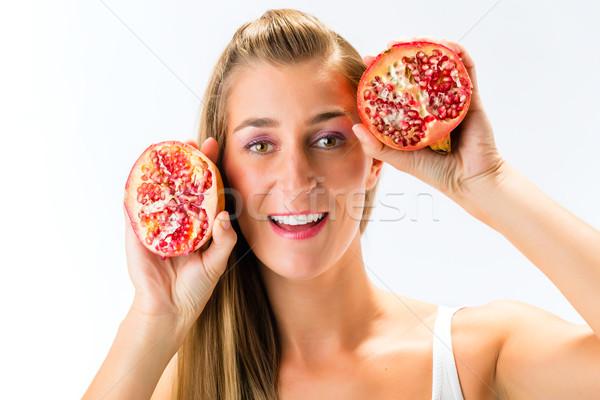 Sağlıklı beslenme kadın nar gıda mutlu meyve Stok fotoğraf © Kzenon