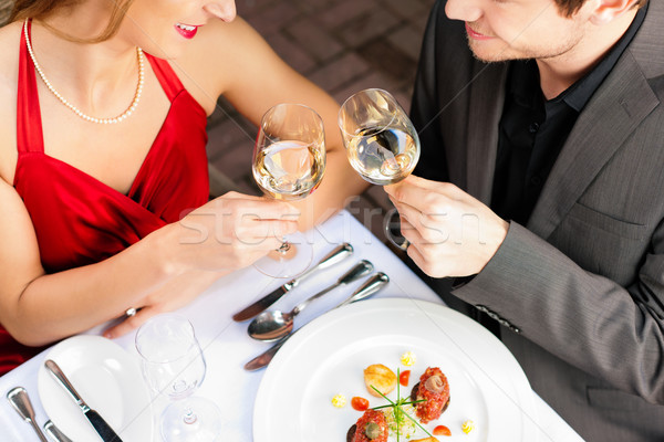 Couple eating and drinking in very good restaurant Stock photo © Kzenon