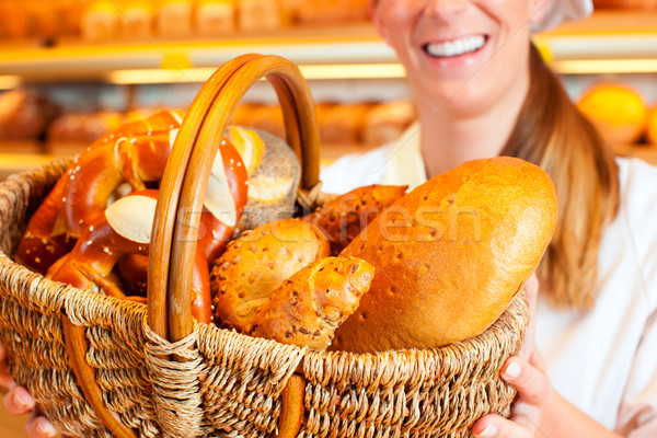 Női pék elad kenyér kosár pékség Stock fotó © Kzenon