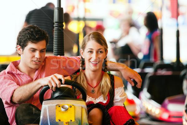 Carnival couple - dodgem Stock photo © Kzenon