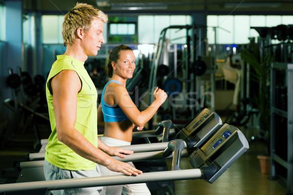 Pár futópad tornaterem edz nő test Stock fotó © Kzenon