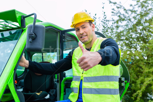 Builder in front of  construction machinery Stock photo © Kzenon