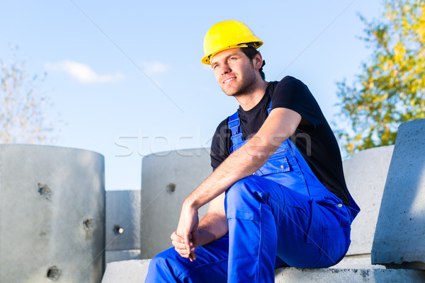 Builder of construction site with canalization project Stock photo © Kzenon