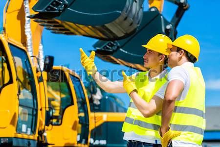 ázsiai építész kotrógép építkezés munkás áll Stock fotó © Kzenon