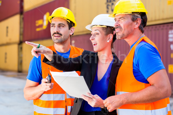 Workers on logistics container port discussing Stock photo © Kzenon