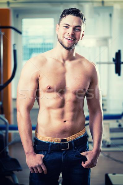 Młodych muskularny człowiek stwarzające topless siłowni Zdjęcia stock © Kzenon