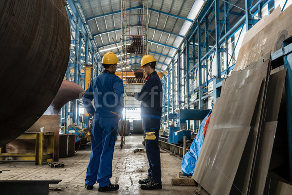 Two workers wearing yellow hard hat and blue uniform Stock photo © Kzenon