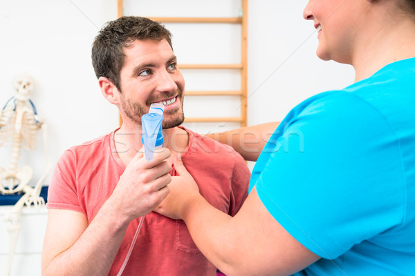 Man taking pulmonary function test with mouthpiece in his hand Stock photo © Kzenon