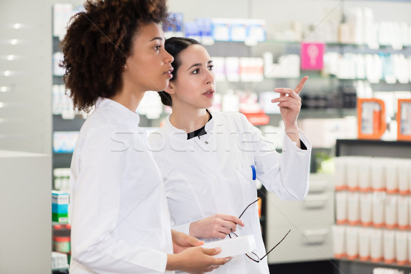 Side view of two dedicated pharmacists looking for the best medicine Stock photo © Kzenon
