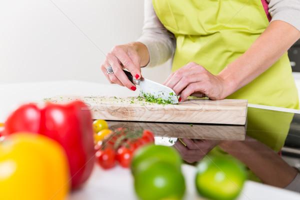 Femme cuisson aliments sains fruits cuisine Photo stock © Kzenon