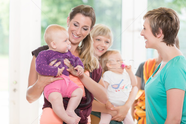 Stock photo: Group of women learning how to use baby slings for mother-child