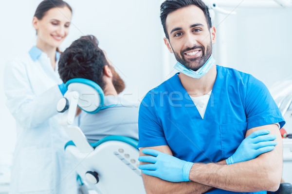 Portrait of a confident dental surgeon in a modern dental office Stock photo © Kzenon