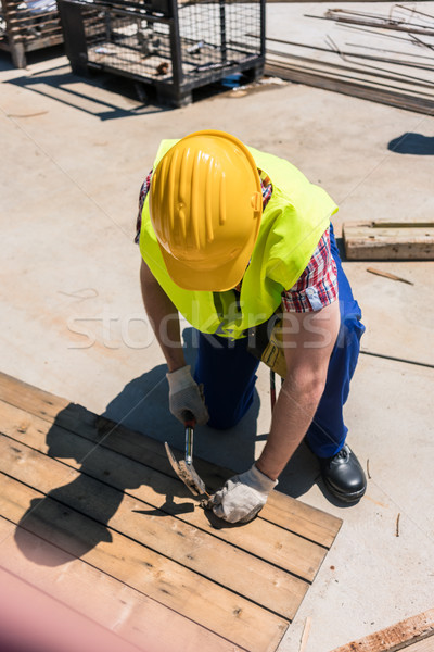 High-angle view of a blue-collar worker using a hammer Stock photo © Kzenon