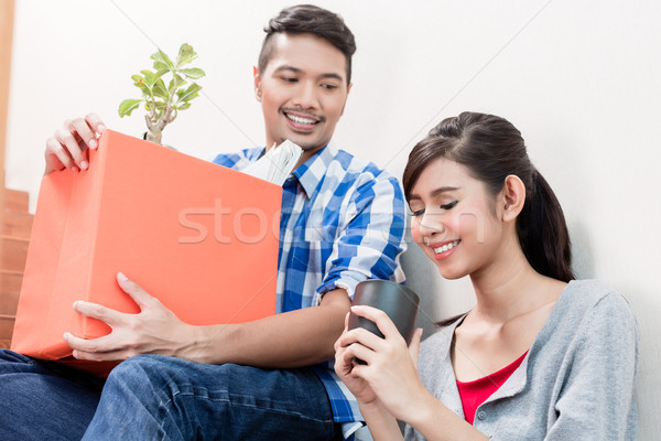 Indonesian couple taking coffee break during relocation Stock photo © Kzenon