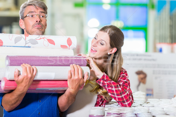 Home improving couple buying wallpapers at hardware store Stock photo © Kzenon