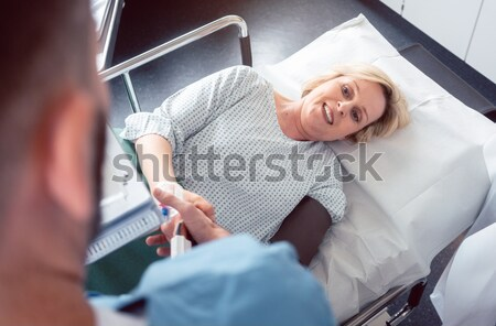 Doctor greeting patient before starting treatment Stock photo © Kzenon