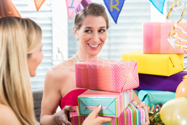 Portrait of a cheerful woman surrounded by presents and party decorations Stock photo © Kzenon