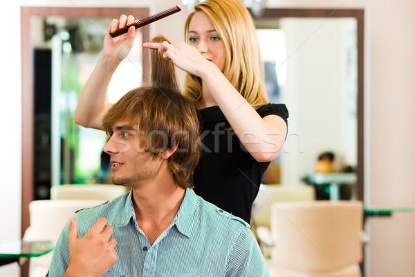 Homme salon de coiffure cheveux femme mains Photo stock © Kzenon
