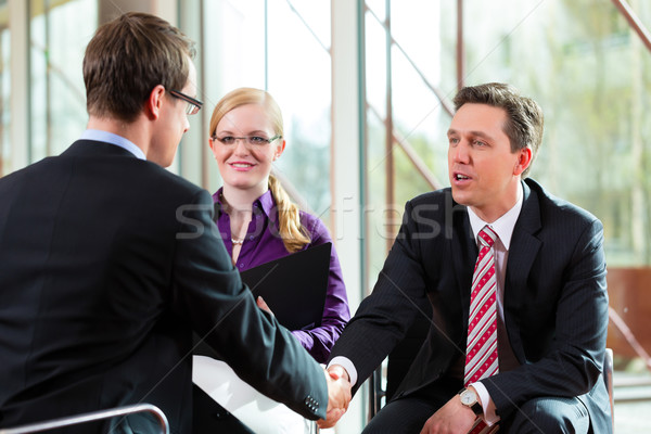 Man having an interview with manager and partner employment job Stock photo © Kzenon