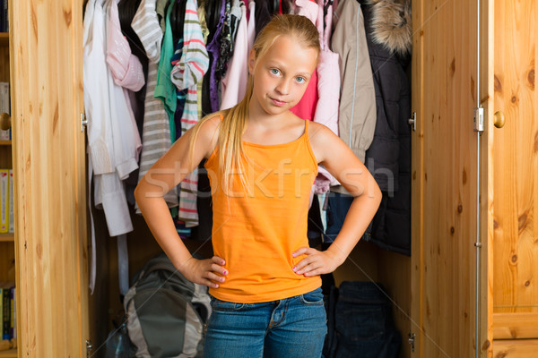 Family - child in front of her closet or wardrobe Stock photo © Kzenon