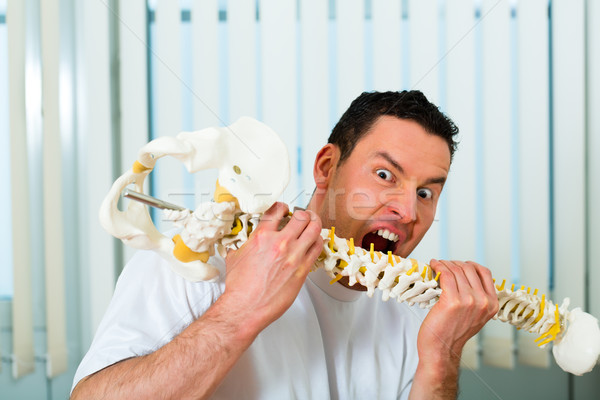 physiotherapist in his clinic being bit crazy Stock photo © Kzenon