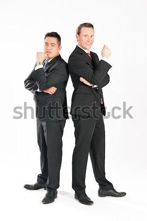 деловые люди Постоянный вместе глядя Сток-фото © Kzenon