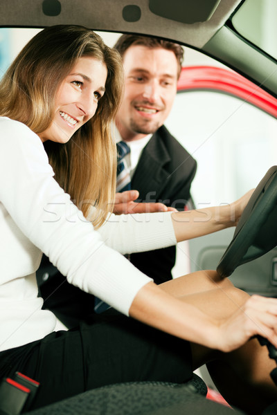 Stock photo: Woman buying car from salesperson