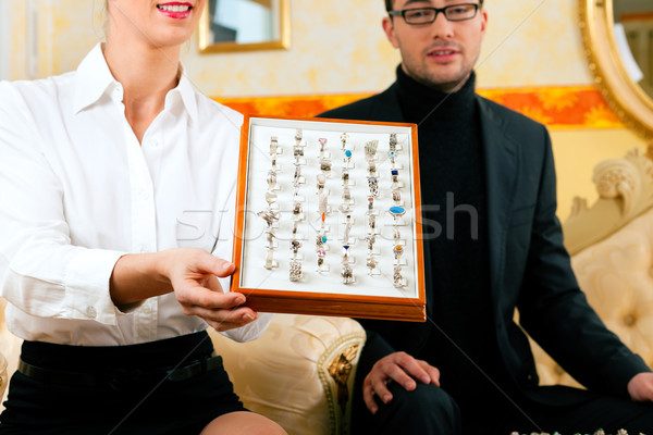 Man choosing a ring at the jeweller Stock photo © Kzenon