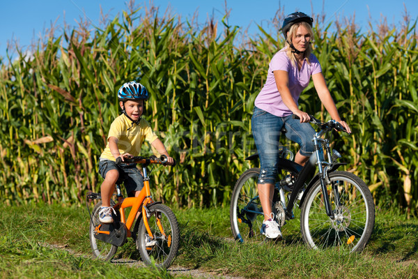 Family is cycling in summer Stock photo © Kzenon
