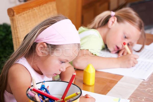 Children doing homework Stock photo © Kzenon