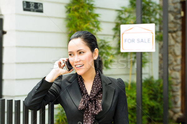 Asian Realtor presenting a new home Stock photo © Kzenon