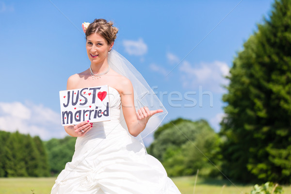 Bride as hitchhiker - wedding concept Stock photo © Kzenon